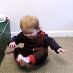 Infant scooting on bottom (bottom shuffling)