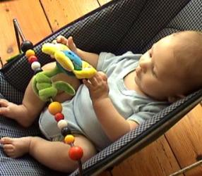W 4m playing hands in bouncy chair (1).jpg